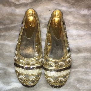 Golden beads shoes.